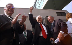 Sen. Robert Byrd, center, was feted Aug. 25, 2006, in Huntington, W.Va., during the dedication of the Robert C. Byrd Biotechnology Science Center, which cost $48 million.