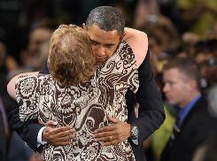 Democratic presidential candidate Sen. Barack Obama hugs a supporter at a Tuesday campaign rally in Golden, Colo. Obama outlined his regulatory system guidelines and hit rival John McCain with a new ad that questioned his statement that the fundamentals of the economy remain strong,