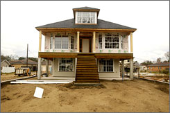 A rebuilt house in the Lakeview area of New Orleans shows the raised level that complies with suggested FEMA guidelines.