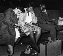 "Three members of a group of college student ""freedom riders"" catch a nap in the Birmingham, Ala., bus station after they were thwarted several times in attempts to board a bus to Montgomery, Ala. Left to right are Susan Hermann, Etta Simpson and Frederick Leonard. All attended college in Nashville On Thursday Sept. 18, 2008, Tennessee State University made amends by presenting former students, including Simpson and Leonard with honorary degrees, three of them posthumously."