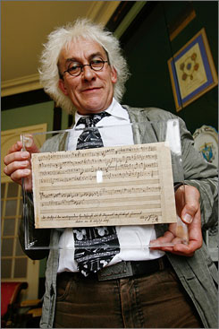 "Nantes, France, vice-mayor Jean-Louis Jossic displays a previously unknown piece of music by Mozart, found by a library as staff were going through its archives, Thursday in the western-France town. Ulrich Leisinger, head of research at the International Mozarteum Foundation in Salzburg, Austria, said Thursday that there is no doubt that the single sheet was written by the composer and that it is ""really important."" He described the work as the preliminary draft of a musical composition."