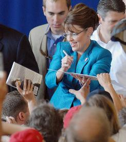 Republican vice presidential candidate, Alaska Gov. Sarah Palin, signs autographs Sept. 19 during a rally at the Anoka County Airport in Blaine, Minn.