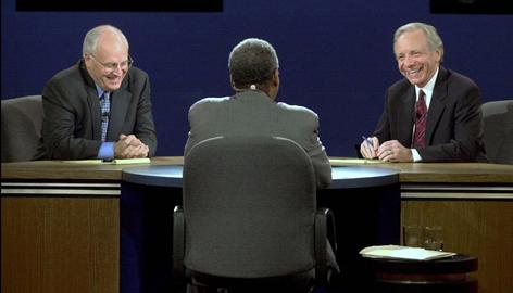Democratic vice presidential candidate Sen. Joseph Lieberman and Republican vice presidential candidate Dick Cheney laugh at a question from moderator Bernard Shaw during their 2000 debate in Danville, Ky.