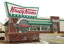 "A Krispy Kreme Doughnuts shop is seen March 15, 2002 in Rosemont, Illinois. The company is planning to build smaller locations that are less expensive to build than its older ""factory store"" model that allowed consumers to watch the doughnuts being made."