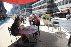 "Carolyn Bielfeldt, left, 28, and her sister Nancy, 23, have lunch at the new esplanade on Broadway  in Midtown Manhattan. ""I think it?s kind of cool, being in the middle of things,"" Nancy Bielfeldt says."