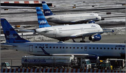 The JetBlue terminal at JFK international airport in New York has been evacuated after discovery of a suspicious package. Here, JetBlue airplanes are seen at the airport in February 2007.