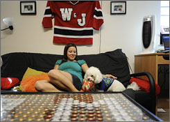 "Kristina Durkoske sits with her ""baby,"" her dog Vinny, in her dorm room at Washington & Jefferson College in southwestern Pennsylvania."