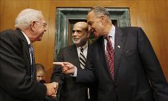 Federal Reserve Chairman Ben Bernanke, center, greets Rep. Jim Saxton, R-N.J., left, and Sen. Charles Schumer, D-N.Y., before testifying Wednesday on Capitol Hill.