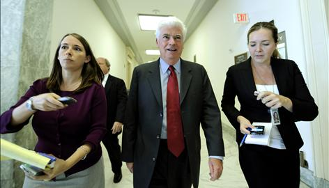 Senate Banking Committee Chairman Christopher Dodd, D-Conn., pursued by reporters on Capitol Hill, has been at the center of bailout negotiations. Since 1989, he has taken more than $13 million in campaign contributions from the financial services sector.
