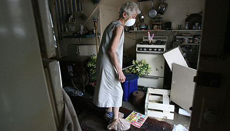 Margaret Dutton looks at her kitchen for the first time in 12 days, since Hurricane Ike came through, as residents who live behind the seawall in Galveston, Texas were allowed to return home on Wednesday.