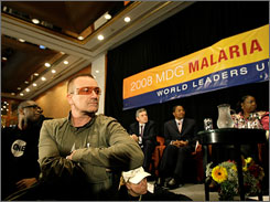 Musicians Youssou N'Dour, of Senegal, left, and Bono listen to speakers at the United Nations 2008 Millennium Development Goals Malaria Summit Thursday in New York.