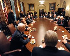 Republican presidential candidate John McCain and rival Barack Obama meet with President Bush and other leaders in the Cabinet Room Thursday at the White House.