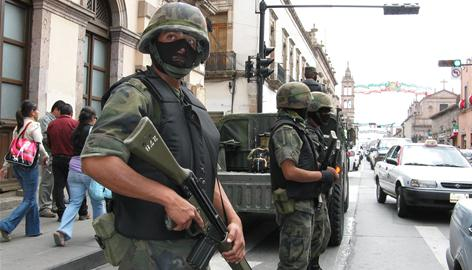 Soldiers wear ski masks in Morelia, the capital of Mexico's Michoacan state, so they cannot be identified by drug traffickers. Twenty-two months after Mexico launched a military offensive against drug gangs by sending troops into Michoacan, many Mexicans are wondering if the violence will ever end.