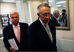 Senate Majority Leader Harry Reid, D-Nev., right, and Senate Banking Committee Chairman Chris Dodd, D-Conn., walk into a news conference on Capitol Hill on Friday.