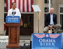  Democratic presidential candidate U.S. Sen. Barack Obama (D-IL) (L) speaks as vice presidental nominee Sen. Joe Biden (D-DE) attends a campaign rally at the J. Douglas Galyon Depot in Greensboro, North Carolina.  