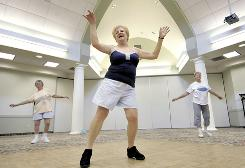 Dottie Ropiak, center, Judi Spitzer, left, and Eileen Deraleau dance in a Zumba class, a fitness program inspired by Latin dance, Aug. 13 at the Enfield Senior Center in Enfield, Conn.