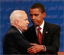Sen. Barack Obama, D-Ill., right, and Sen. John McCain, R-Ariz., shake hands after their presidential debate in Oxford, Miss., on Friday night.
