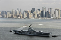The USS Intrepid aircraft carrier is towed to a repair facility in New Jersey in this December 2006 file photo in New York.