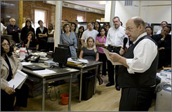 "New York Sun Editor-in-Chief Seth Lipsky announces the closure of the newspaper to the staff Monday at the paper's newsroom in New York. The original Sun, founded in 1833, was a pioneering newspaper which helped found The Associated Press and was known for its ""Yes, Virginia, there is a Santa Claus"" column."