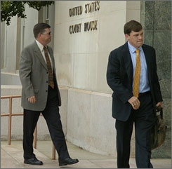 Suspended South Carolina state trooper Steve Garren, left, arrives at the Federal Courthouse in Greenville, S.C. Monday with attorney Wally Fayssoux.