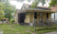 Joanne Smith, 30, from Chicago won an eBay auction for this abandoned home in Saginaw, Mich. with a bid of $1.75.