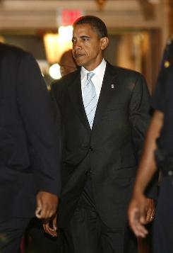 "Democratic presidential candidate Sen. Barack Obama arrives at the Capitol for a vote on the financial rescue plan on Wednesday night. In a speech on the Senate floor he said the crisis ""affects the financial well-being of every American."""