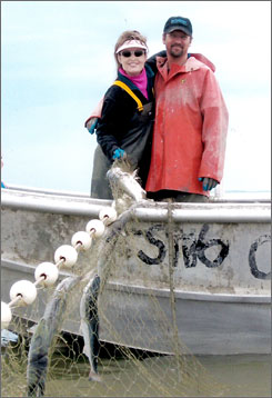 In a July 2006 file photo provided by the Palin family, Alaska Gov. Sarah Palin, left, and her husband, Todd Palin, pause from commercial fishing in Dillingham, Alaska.