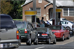 """By the weekend, AAA says, there won't be """"superlong"""" lines at gast stations in Charlotte, such as this one on Tuesday."""