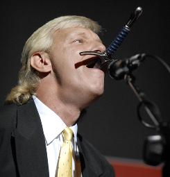 """Dan Meyer of Antioch, Tenn., reiterates his findings on """"Sword Swallowing and its Side Effects""""  at the Ig Nobel award ceremony at Harvard University Thursday in honor of this year's theme of """"Redundancy."""" Meyer won the award in 2007."""