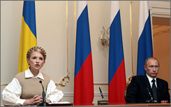 "Russian Prime Minister Vladimir Putin, right, called Ukranian arms deliveries to Georgia a ""crime"" in comments after meeting his Ukranian counterpart Yulia Timoshenko Thursday."