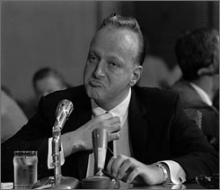 "Former Las Vegas casino owner Frank ""Lefty"" Rosenthal sits at a Senate witness table Sept. 8, 1961 in Washington D.C. during a probe of organized gambling."