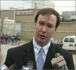 U.S. Attorney for South Carolina Walt Wilkins talks with reporters outside the House of Raeford's Columbia Farms chicken processing plant in Greenville, S.C. Tuesday.