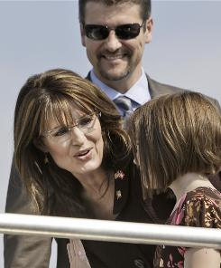 Republican vice presidential candidate, Alaska Gov. Sarah Palin, center, talks with her daughter Piper and her husband, Todd Palin before boarding the campaign plane Oct. 4 to leave Dallas.