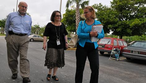 From left: Medicare investigators Peter Ashkenaz, Cecilia Franco and Suzanne Bradley visit a Medicare recipient's home in Miami.