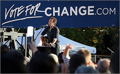 Bruce Springsteen performs during a rally for Democratic presidential candidate Barack Obama on Sunday at Ohio State University in Columbus. 'The Boss' was scheduled to perform Monday at Eastern Michigan University. 