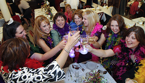 Fundraisers, from left, Patrice Senac, Tiffany Cortes, Stacy Seamon, Beverly Seamon, Janice Grimaldi, Elizabeth Kennedy, Ginga Guidroz and Lizzie Fontenelle toast before an annual auction at Galatoire's Restaurant in New Orleans, which this year tallied $58,000 for police and animal causes.