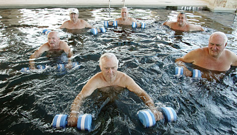 Don Iburg, 76, center, leads a water exercise class in the solar-heated pool at Querencia at Barton Creek, a senior living community in Austin.