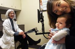 Karissa Aleskus and her two-month-old Jack visit Valerie King, a family practice doctor who specializes in caring for women and children at Oregon Health and Sciences University, for Jack's checkup and immunizations.