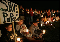 Union members and their families hold a candlelight vigil in Kimberly, Wis., in August outside the soon-to-close NewPage paper mill.