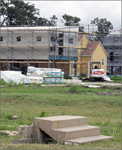 The economic crisis could stall recovery efforts, like here where the steps of a former home sit in front of new construction in New Orlean's Lower 9th Ward.