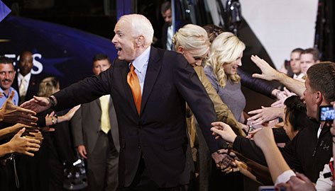 Republican presidential candidate John McCain arrives at a rally in Bethlehem, Pa., Wednesday, with wife Cindy and daughter Meghan.