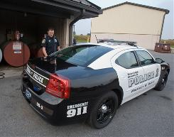 Officer Michael Cardell fuels a Dodge Charger at the Berks-Lehigh Regional Police Department in Kutztown, Pa. The department recently added three Chargers with more fuel efficient V6 engines to its fleet.