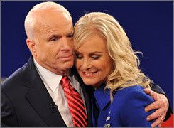 Cindy McCain, hugging husband John, after Tuesday's debate, said she initally didn't want him to seek the GOP nomination after a brutal 2000 primary struggle against George W. Bush.