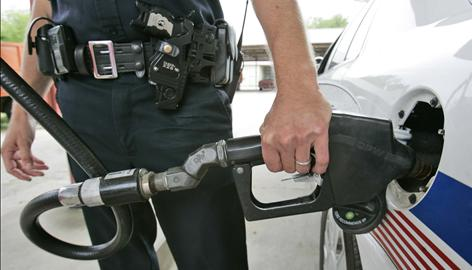 High gasoline prices and the economic crisis have police departments re-evaluating their vehicle fleets. The crunch at the pump has made some departments buy different patrol cars to save money.