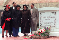 Coretta Scott King, second from right, gathers at the gravesite of her husband, with her family, from left to right, Christine King Farris, Dexter, Bernice and Martin, on the 32nd anniversary of his death.