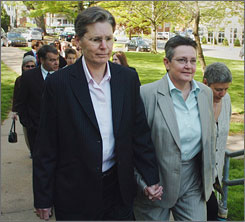 "Plaintiffs Janet Peck, left, and her partner of 33 years, Carol Conklin, said they were ""thrilled"" with the court's 4-3 decision."