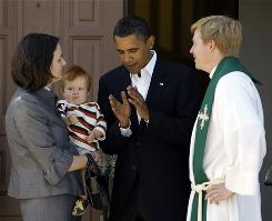Sen. Barack Obama talks with married pastors Katherine and Lars Olson and son Carl Olson, 11 months, after attending church at St. Luke's Lutheran Church in Lima, Ohio, Aug. 31.