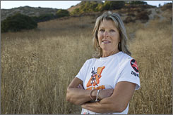 Breast cancer survivor Louise Cooper, 55, jogs in the hills in West Hills, Calif., near her home, thanks to Herceptin. She was given the targeted therapy 10 years ago, when she had an early tumor, to prevent relapses.