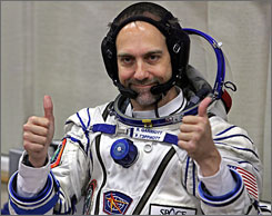 U.S. space tourist Richard Garriott gestures after putting on a space suit at the Baikonur cosmodrome in Kazakhstan prior to launch on Sunday.