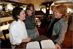From left, chef and co-owner Traci Des Jardins goes over a menu for a wedding reception with Chloe Harris and Frankie Frankeny at Jardiniere restaurant in San Francisco, on Oct. 2. Gay couples from across California and the nation are feverishly planning to tie the knot before Election Day to avoid possible passage of a California ballot initiative aimed at banning same-sex marriage.